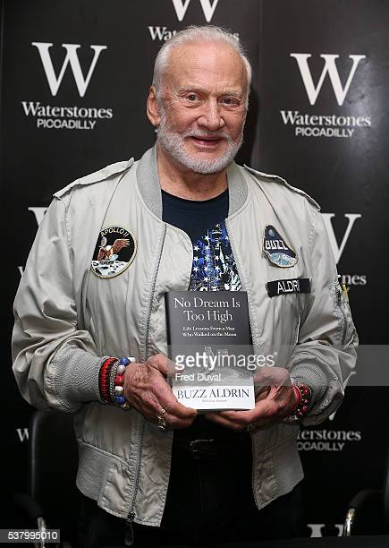 Buzz Aldrin signs copy of his book No Dream Too High on June 4 2016 in London England