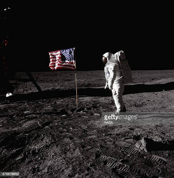 Buzz Aldrin stands beside an American flag at Tranquility Base on the surface of the moon during the Apollo 11 mission