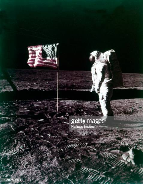 Buzz Aldrin stands next to the American flag on the surface of the Moon Apollo 11 mission July 1969 US astronaut Edwin E Buzz Aldrin Jr lunar module...