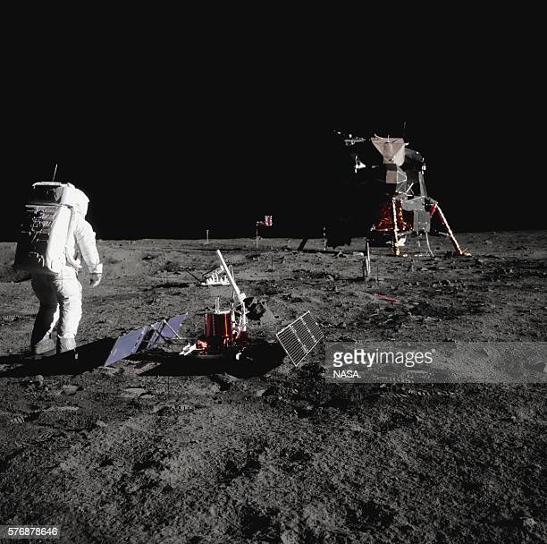 Buzz Aldrin walks by some scientific equipment on the surface of the Moon during the Apollo 11 mission