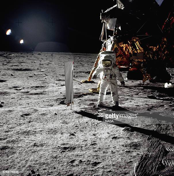 Buzz Aldrin walks next to the Eagle lunar module onto the surface of the Moon during the Apollo 11 mission