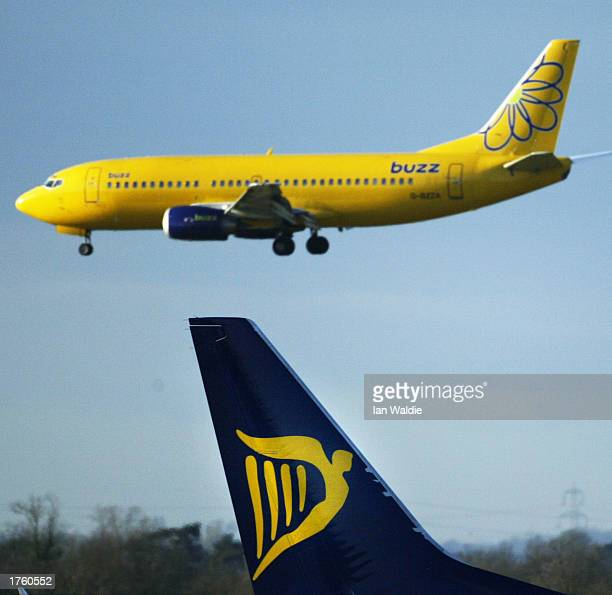 Buzz jet lands in back of a Ryanair jet at Stansed airport February 4 2003 in London United Kingdom Ryanair a lowbudget airline announced pretax...