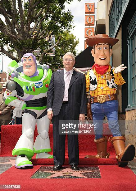 Buzz Lightyear and Woody of Disney Pixar's Toy Story 3 celebrate compser Randy Newman with a star on the Hollywood Walk Of Fame on June 2 2010 in...