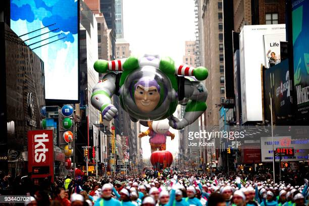 Buzz Lightyear balloon floats thru Times Sq during the 83rd annual Macy's Thanksgiving Day Parade on the streets of Manhattan on November 26 2009 in...