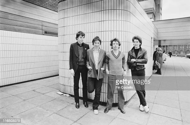 drummer John Maher guitarist Steve Diggle guitarist and singer Pete Shelley and bassist Steve Garvey British punk band pose for a group portrait...