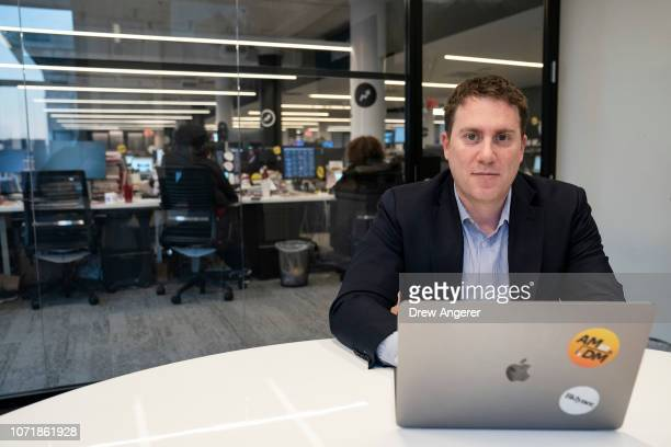 BuzzFeed News EditorinChief Ben Smith poses for a picture in his office in the newsroom at BuzzFeed headquarters December 11 2018 in New York City...