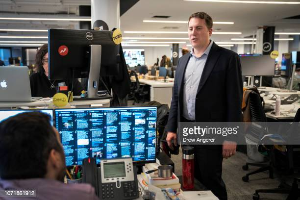 BuzzFeed News EditorinChief Ben Smith talks with colleagues in the newsroom at BuzzFeed headquarters December 11 2018 in New York City BuzzFeed is an...