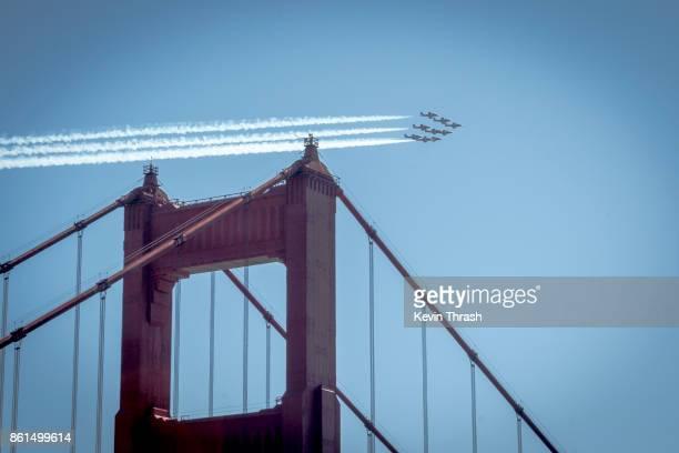 buzzing the bridge - fleet week stock photos and pictures