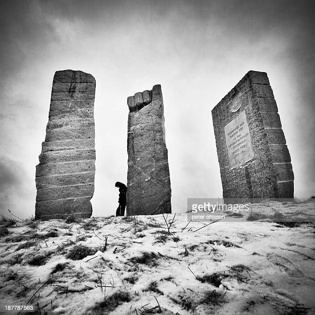 Bw fine art photo of a man leaning against an obelisk