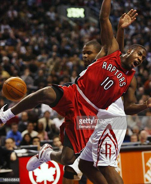 BW03_Raptors_111603Raptor's Milt Palacio is clotheslined by Houston's Alton Ford during first half action