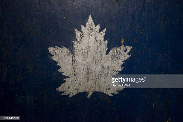 BW_Gardens092909 An old style rendition of the Toronto Maple Leafs logo is painted on a large box abandoned on the second level of the Maple Leaf...