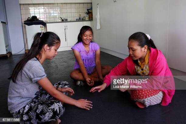 Bway Ku Gay plays with family at her home on January 27 2017 in Tamworth Australia Tamworth is a large regional city in the New England region of...