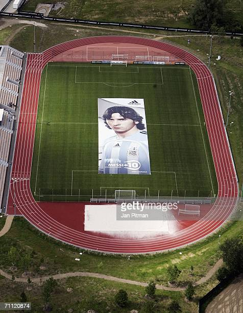 A 60 by 15 metre big poster of Lionel Messi from the national team of Argentina is diplayed at the World of Sports Stadium on June 4 2006 in...