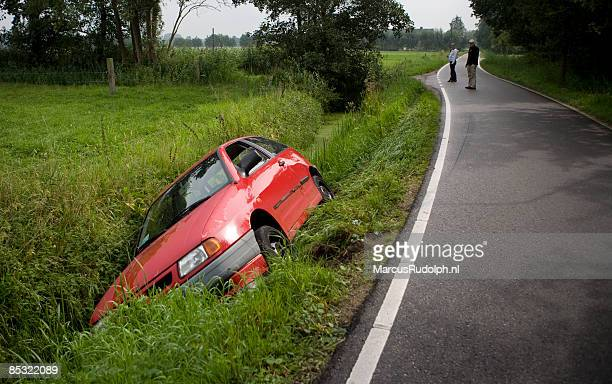 by accident car got stuck in ditch - ditch stock photos and pictures