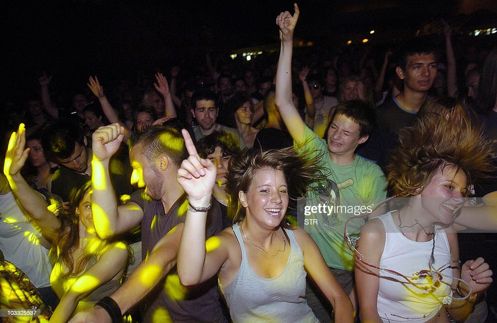 STORY by ALEKSANDRA NIKSIC-- This undated photo shows party goers dancing during an open air concert in Belgrade. Serbia's once-isolated capital Belgrade is gaining fame as one of the world's top party towns, luring hordes of young budget travelers with open-air music festivals and underground dance clubs.