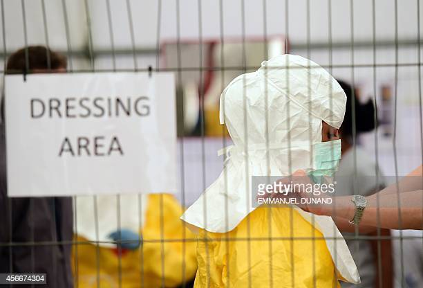 STORY by Alex PIGMAN Volunteers take part in training at a Doctors Without Borders replica of Ebola treatment centres prior to be sent to help fight...