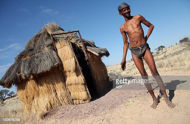 STORY by Alexandra Lesieur This photo taken on July 4 2010 shows a bushman known in the community as Gert standing in front of a traditional bushveld...