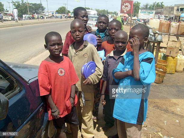 By Aminu Abubakar A group of child beggars stand in the streets of Kano on November 17, 2009. The number of child beggars in Kano State has increased...