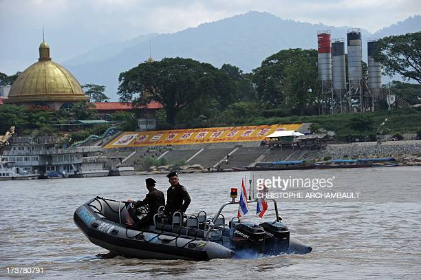 CRIME' by Amélie BOTTOLLIER This picture taken on May 28 2013 shows policemen from the Thai Marine Border Police patroling along the Mekong river...