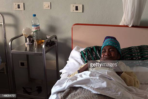 STORY by Andreea Campeanu A picture taken on May 29 2012 shows a woman sick with Tuberculosis resting at the hospital of the congregation 'The Little...
