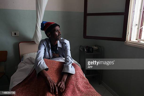 STORY by Andreea Campeanu A picture taken on May 29 2012 shows Jean Louis Talata sick with Tuberculosis resting at the hospital of the congregation...