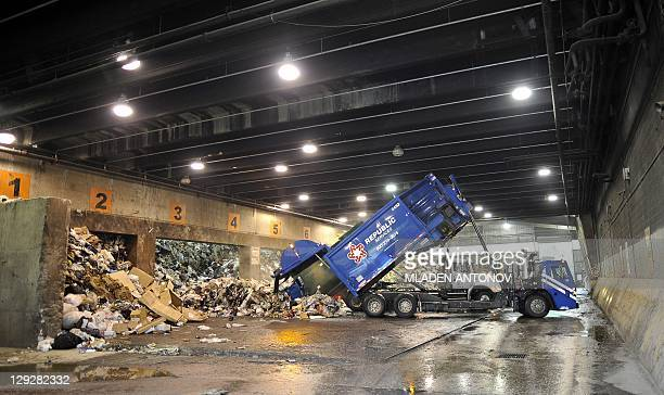 STORY by Andrew BEATTY A picture made October 14 2011 shows unloading garbage trucks at the Harrisburg's incinerator Pennsylvania's state capital has...