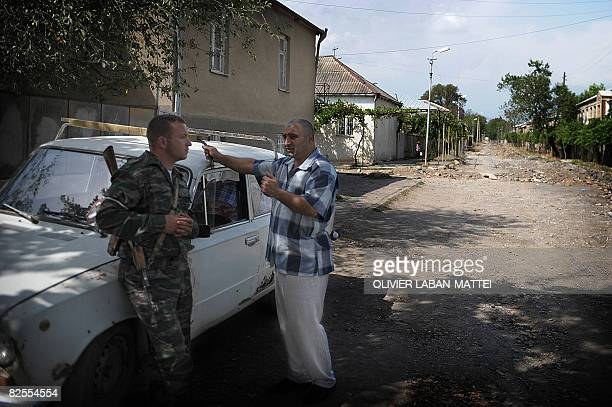 STORY by Antoine Lambroschini Nukzar a Georgian citizen of Akhalgori South Ossetia argues with an Ossetian militiaman before escaping the city to go...