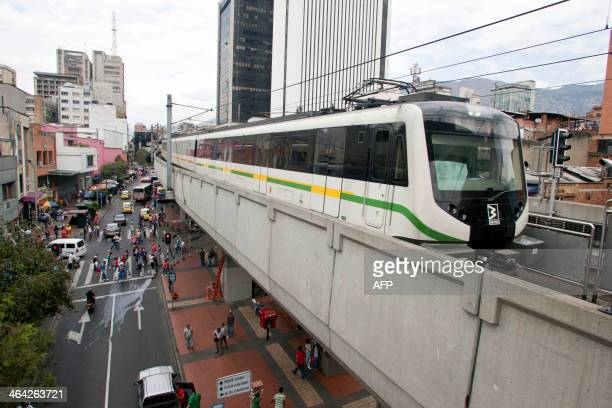 STORY by Ariela Navarro Picture of the metro arriving at a station in Medellin Antioquia department Colombia on January 5 2014 In 2013 Medellin was...