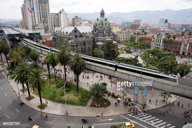STORY by Ariela Navarro Picture of the metro leaving a station in Medellin Antioquia department Colombia on January 5 2014 In 2013 Medellin was...
