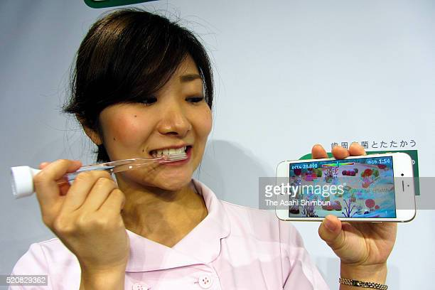 By attaching Sunstar Inc's new GUM Play device to the bottom of a toothbrush a game can be enjoyed on smartphones via movements of the toothbrush...