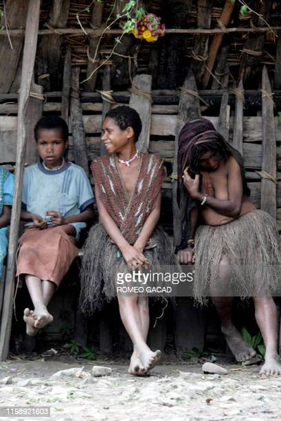 """By Aubrey Belford Papuanese girl wear traditional Papua's clothing """"Koteka"""" in Kurulu on November 22, 2008. Wearing nothing but feathers and a long,..."""