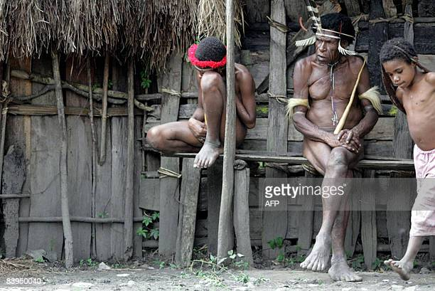 By Aubrey Belford Papuanese men wear traditional Papua's clothing Koteka in Kurulu on November 22 2008 Wearing nothing but feathers and a long...
