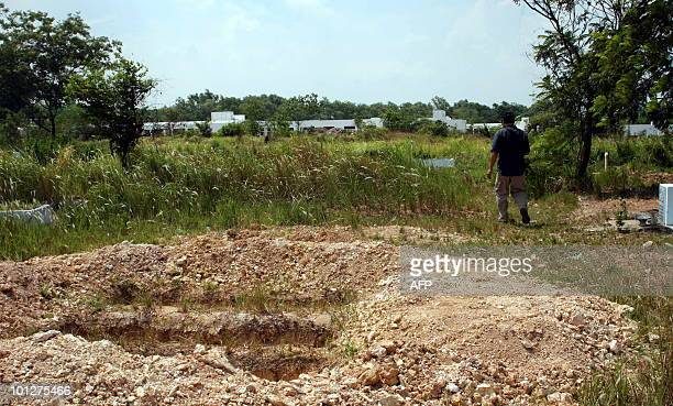 STORY 'STORY VIETNAMFRANCEEDUCATIONEXECUTION' by Aude GENET This photo taken on May 23 2010 shows a student's father walking through a graveyard for...