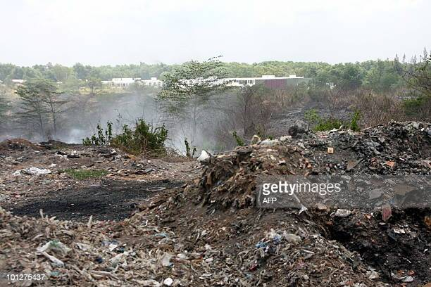 STORY 'STORY VIETNAMFRANCEEDUCATIONEXECUTION' by Aude GENET This photo taken on May 23 2010 shows smoke coming from a smouldering illegal garbage...