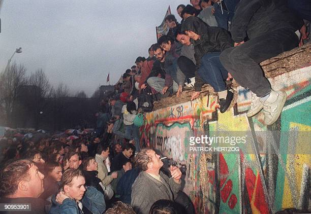 """By Audrey KAUFFMANN and PACKAGE """"Germany-east-History-20years"""" FILES - People from East Germany greet citizens of West Germany at the Brandenburg..."""
