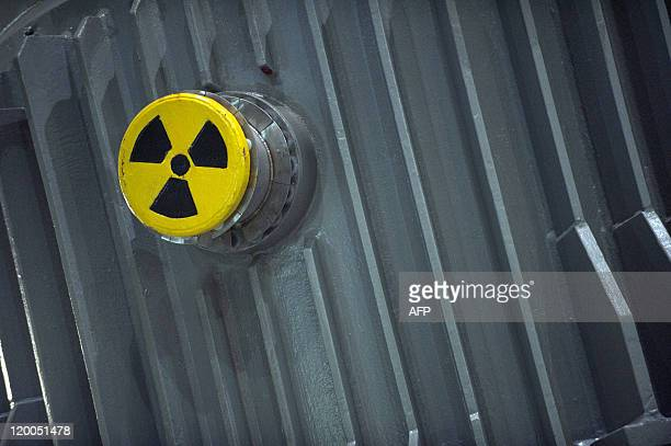 STORY by AURELIA END The sign for nuclear radiation can be seen on a castor containing nuclear waste at the Zwischenlager Nord interim storage...