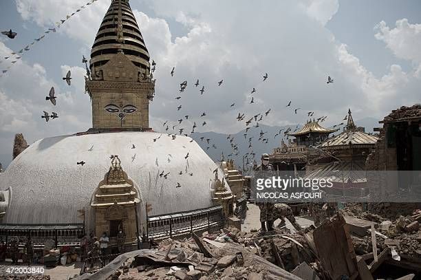 BUDDHISM by Beatrice Le Bohec This picture taken on May 2 shows Nepalese soldiers clearing rubble of a building at the damaged Swayambhunath temple...