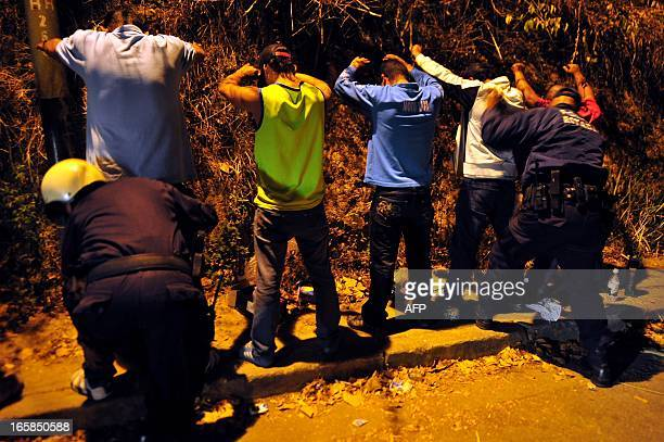 STORY by Beatriz Lecumberri Policemen frisk people in search of drugs and guns in Los Teques capital of the Venezuelan state of Miranda on April 4...