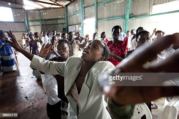 STORY by Ben SIMON A Ugandan woman joins others in prayer during a ceremony where Ugandan Pentecostal pastor Joshua Magezi blessed his congregant�s...