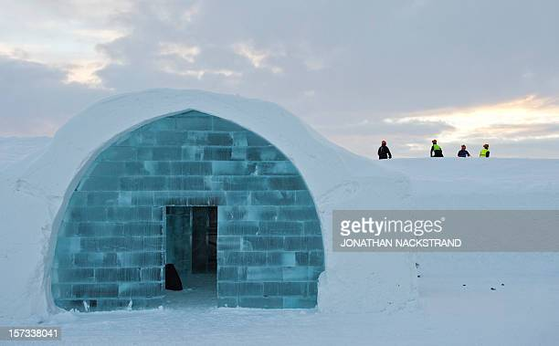 STORY by CAMILLE Workers are seen at the construction site of the new Ice Hotel in the village of Jukkasjarvi near Kiruna in Swedish Lapland on...