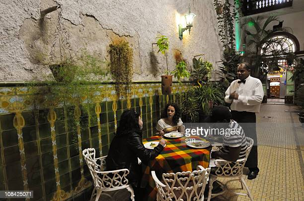 STORY by Carlos Batista An employee at the 'paladar' 'San Cristobal' talks with customers on January 9 2011 in Havana Following the new economic...
