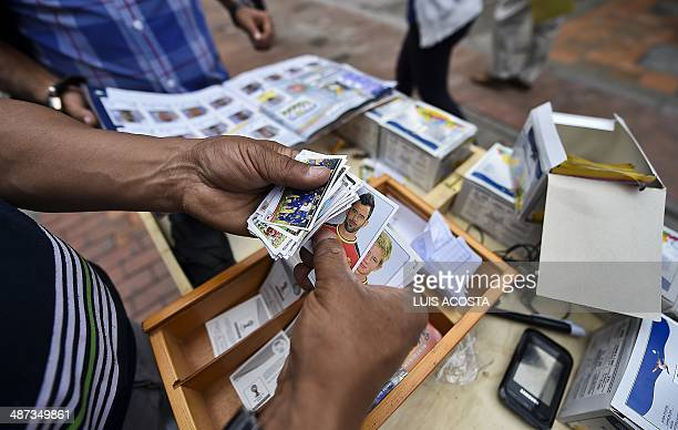 STORY by Carlos Rodriguez A peddler sells Panini's collectible stickers for the FIFA World Cup Brazil 2014 album in Bogota on April 28 2014 AFP...