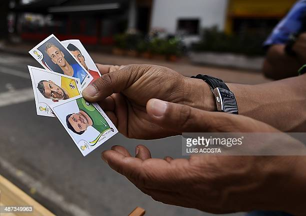 STORY by Carlos Rodriguez A peddler shows Panini's collectible stickers for the FIFA World Cup Brazil 2014 album in Bogota on April 28 2014 AFP...