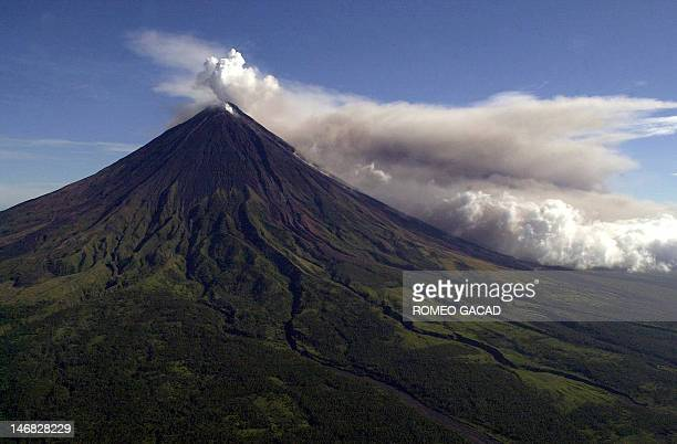 STORY PHILIPPINESLIFESTYLETOURISMVOLCANOFEATURE by Cecil Morella An ash and steam cloud rises above the Mayon volcano crater 07 March 2000 The...