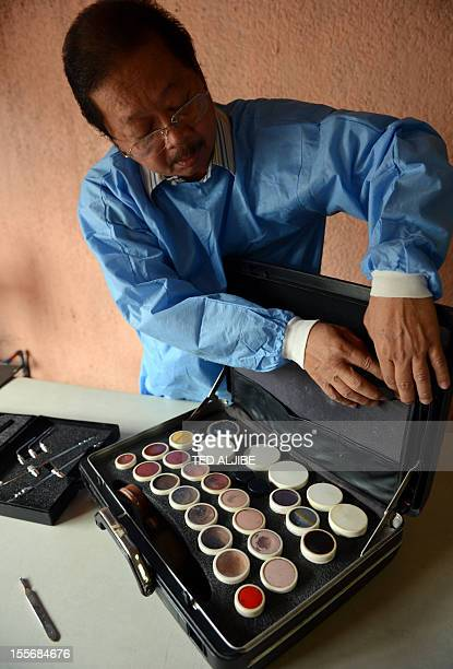 STORY 'PHILIPPINESPEOPLEMORTICIAN' by Cecil Morella Filipino mortician Franck Malabed arranges his embalming equipment at his residence in Manila on...