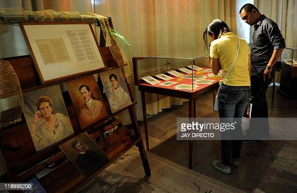 FEATURE by Cecil Morella In this photo taken June 17 students view the restored handwritten novels the original editions of national hero Jose...