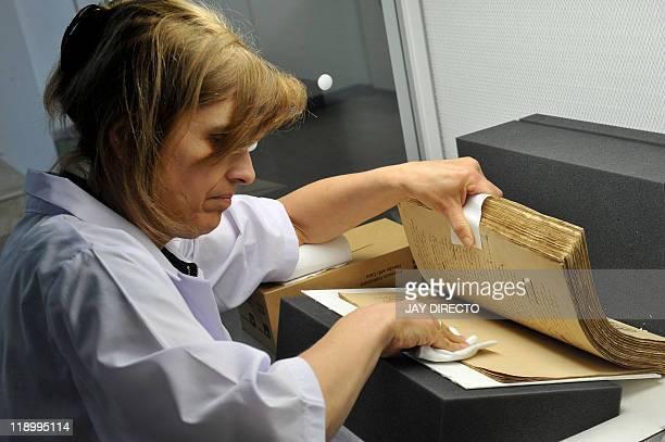 FEATURE by Cecil Morella In this photo taken May 4 German restorer Monika SchneiderGast works on restoring the handwritten novels the original...