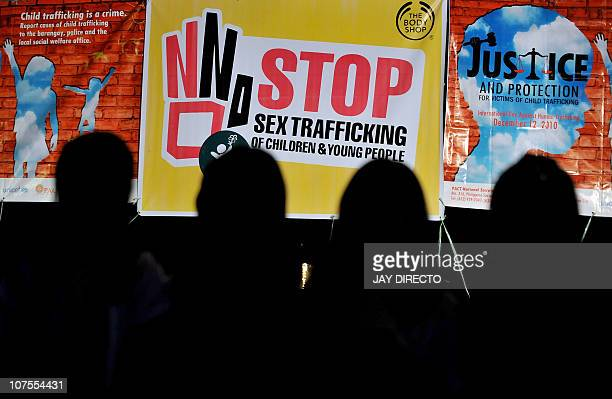 STORY LIFESTYLEITPHILIPPINESCRIMEPORNOGRAPHY by Cecil MorellaChildren are silhouetted in front of posters displayed during a prayer for Justice and...