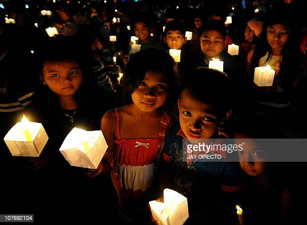 STORY 'LIFESTYLEITPHILIPPINESCRIMEPORNOGRAPHY' by Cecil MorellaChildren hold lighted candles during a prayer for Justice and Protection against Sex...