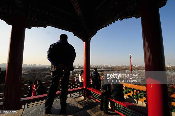 COUNTDOWN6MONTHS by Charles Whelan People take in the view of central Beijing from the top of Coal Hill or Jingshan Park looking northward along the...